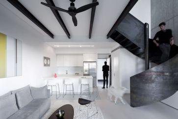 Minimalist-Duplex-Nam-by-gerstner-featuring-a-spiral-staircase-design
