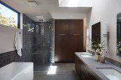 San-Mateo-house-features-a-stylish-master-bathroom-with-a-glass-shower