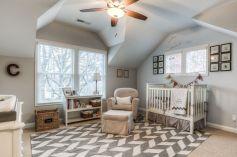 Traditional-nursery-room-with-armchair-and-bookshelf-storage