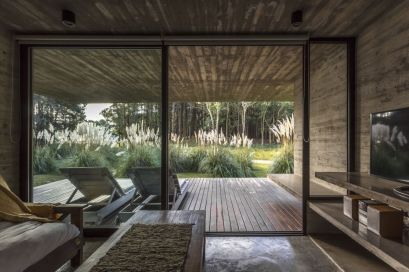 Living-and-porch-Concrete-forest-House-by-Besonias-Almeida-Arquitectos