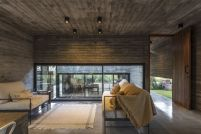 Small-seating-area-Concrete-forest-House-by-Besonias-Almeida-Arquitectos