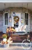 Porch-decorated-for-fall-with-a-swing