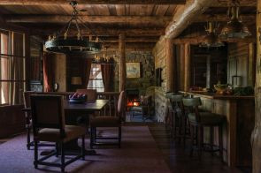 Rustic-mountain-residence-in-in-Teton-Valley-Wyoming-open-space-kitchen-with-bar