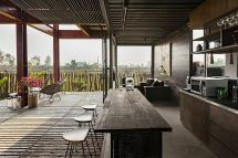Three-story-residence-from-recycled-shipping-containers-reclaimed-wood