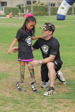 Ricks with Haven, a young girl from Missouri whom he has helped mentor.