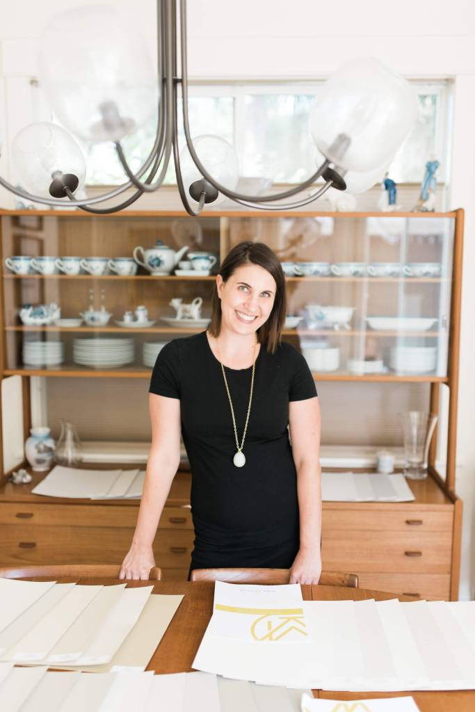 Krissy Peterson standing at work table