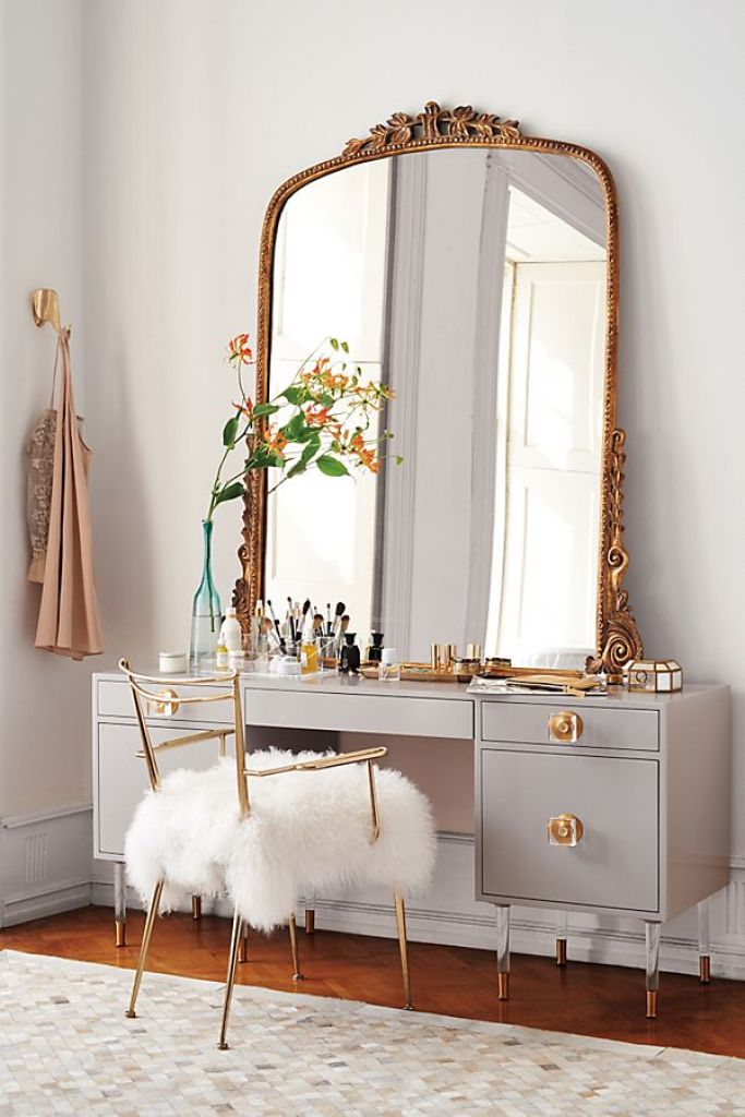 A vintage-style Anthropologie mirror styled with a modern vanity with lucite details.