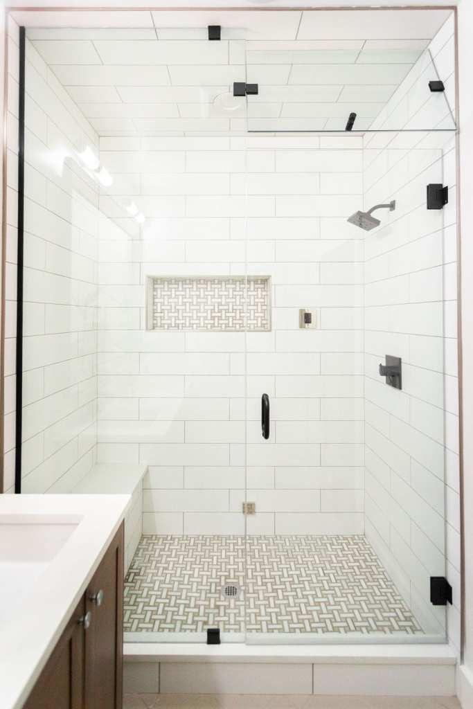 Modern guest bathroom with a basketweave mosaic tile