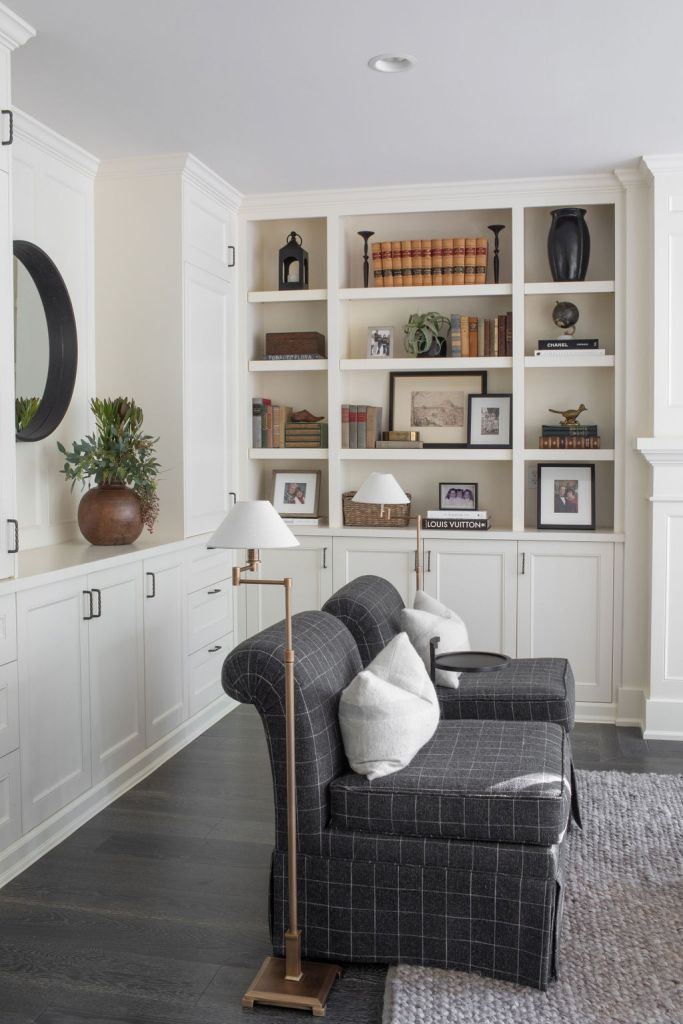 white built-in shelving in living room with grey slipper chairs