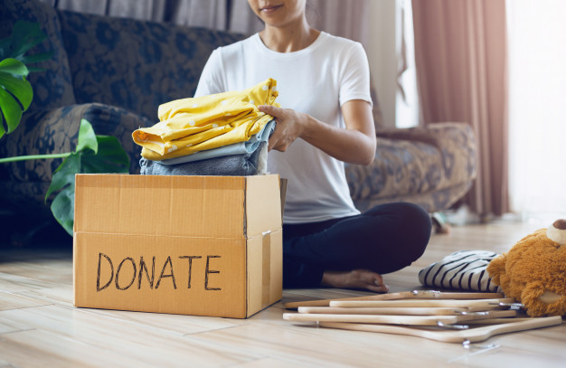 woman sorting for donation
