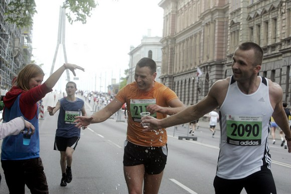 Runners grabbing water during a marathon
