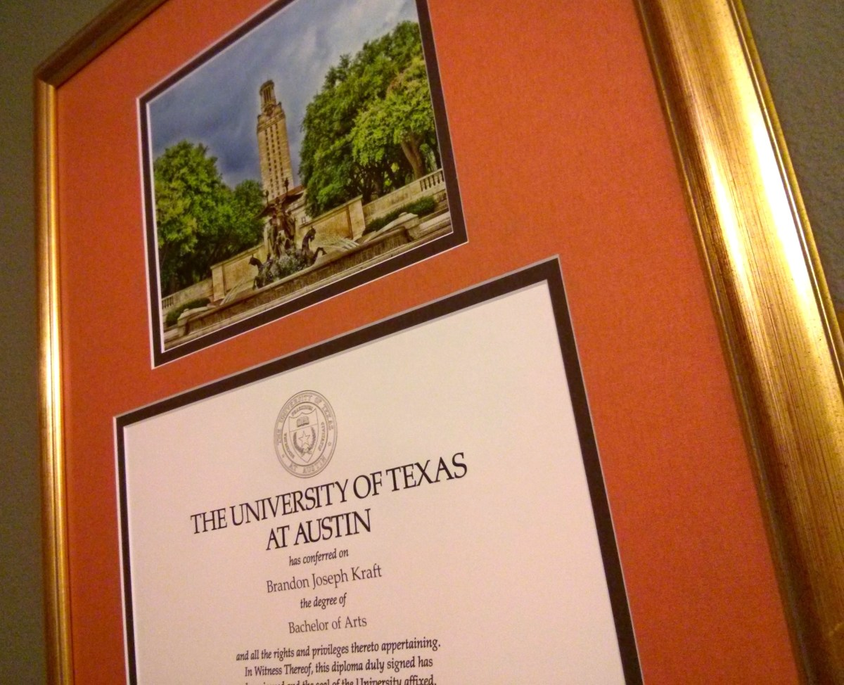 A diploma from The University of Texas in a frame.