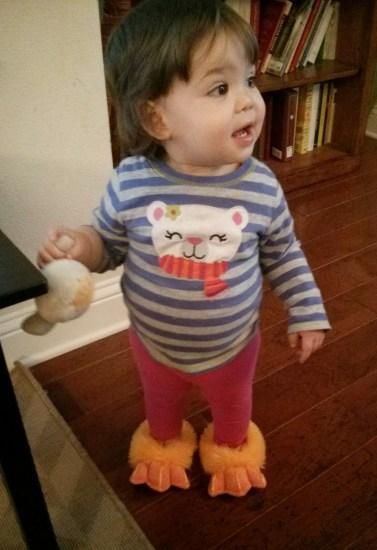 A toddler wearing duck feet.
