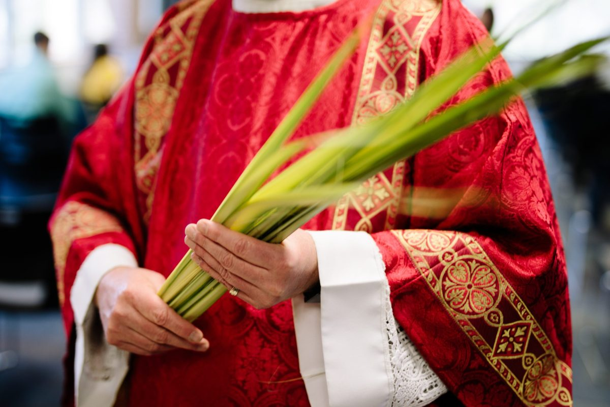 Priest holding palms