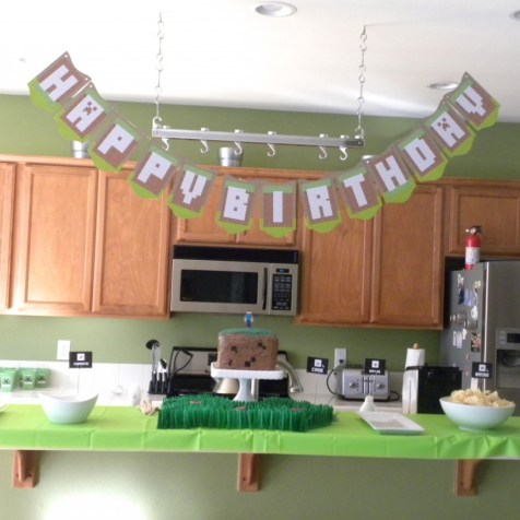 Party banner, cake and food.