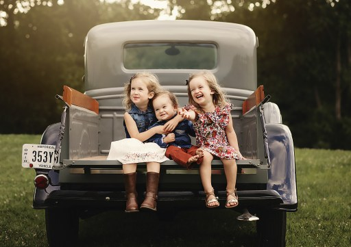 outdoors family photography with small children in vintage truck