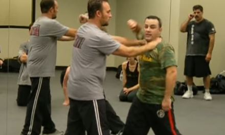 Defense against front choke with a push demonstration