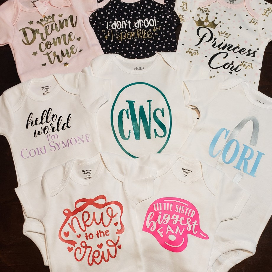 Variety of custom onesies for a newborn with various heat transfer designs
