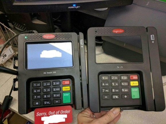 """An """"overlay"""" skimming device (right) that was found attached to a card reader at a retail establishment."""