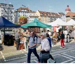 Lucerne flea market stalls along the Reuss river