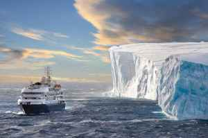 The cruise ship Corinthian II in front of a huge Iceberg in Antarctic Sound. Antarctic Sound is at the northern tip of the Antarctic Peninsular and connects the Southern Ocean to the Wedell Sea. Even in the summer months it is often filled with huge tabul