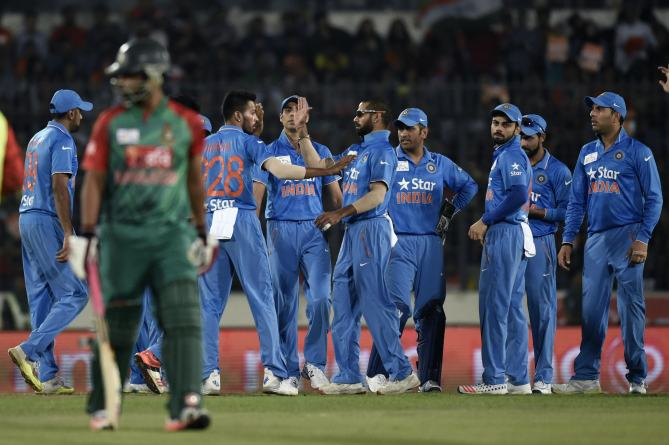 Indian-cricketers-celebrate-after-the-dismissal-of-the-Bangladesh-cricketer-Tamim-Iqbal