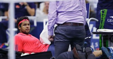 injured opponent. Jo-Wilfried Tsonga
