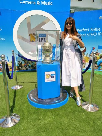 Actress Surveen Chawla clicks a picture with the VIVOIPL trophy in Ranch...