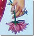 [Sita Devi holding a flower]