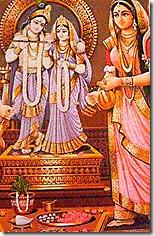 [Worshiping Radha-Krishna deities]