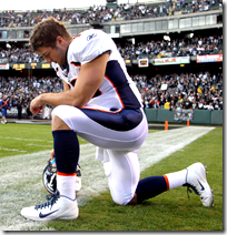 [Football player praying]