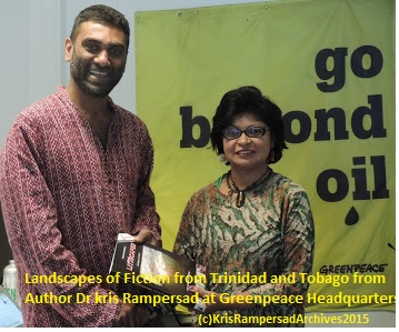 Head of Greenpeace Dr Kumi Naidoo receives a copy of LiTTscapes Landscapes of Fiction from Dr Kris Rampersad