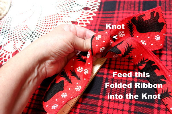feed ribbon into knot