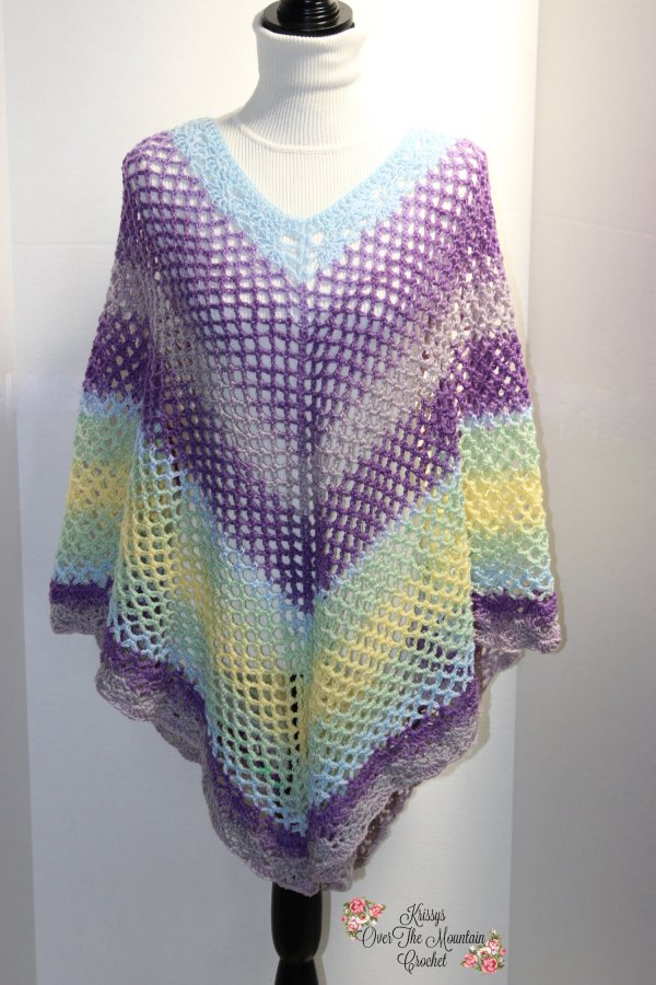Crochet this beautiful mesh Over Brook Poncho to wear for a walk along the beach or a cool summer night.