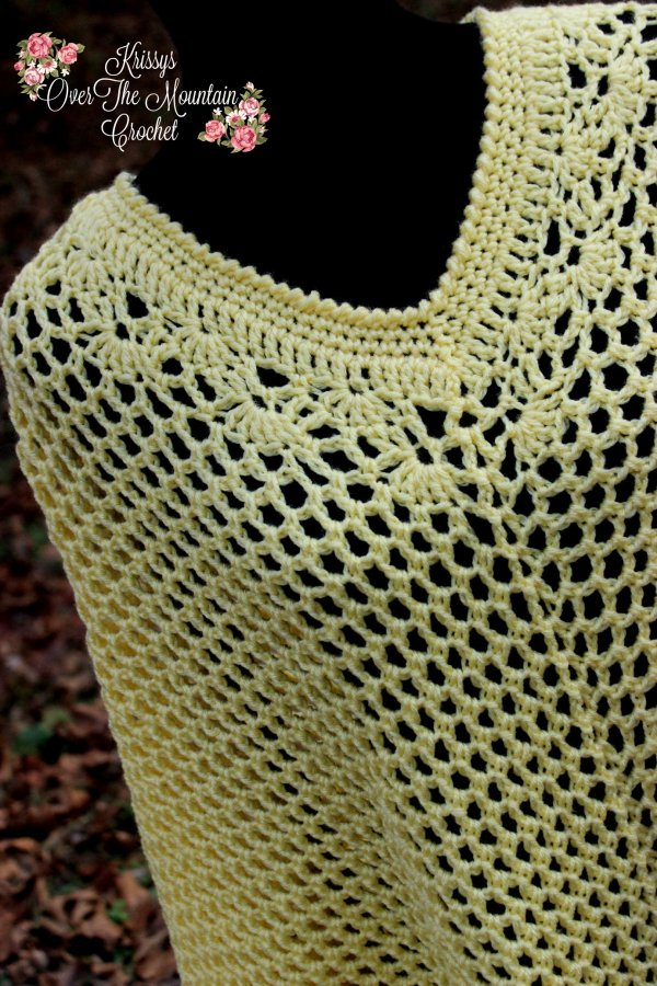 The crochet lace on the neckline of the Fall Mesh Poncho is just beautiful! I love how delicate the lace work is.