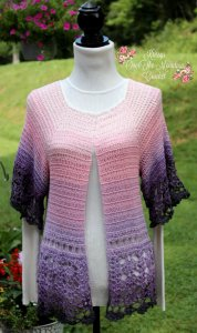 A beautiful Mountain Sunrise crocheted sweater is so beautiful. The crochet pattern is perfect to use a yarn that has color graduating just like a mountain sunrise.