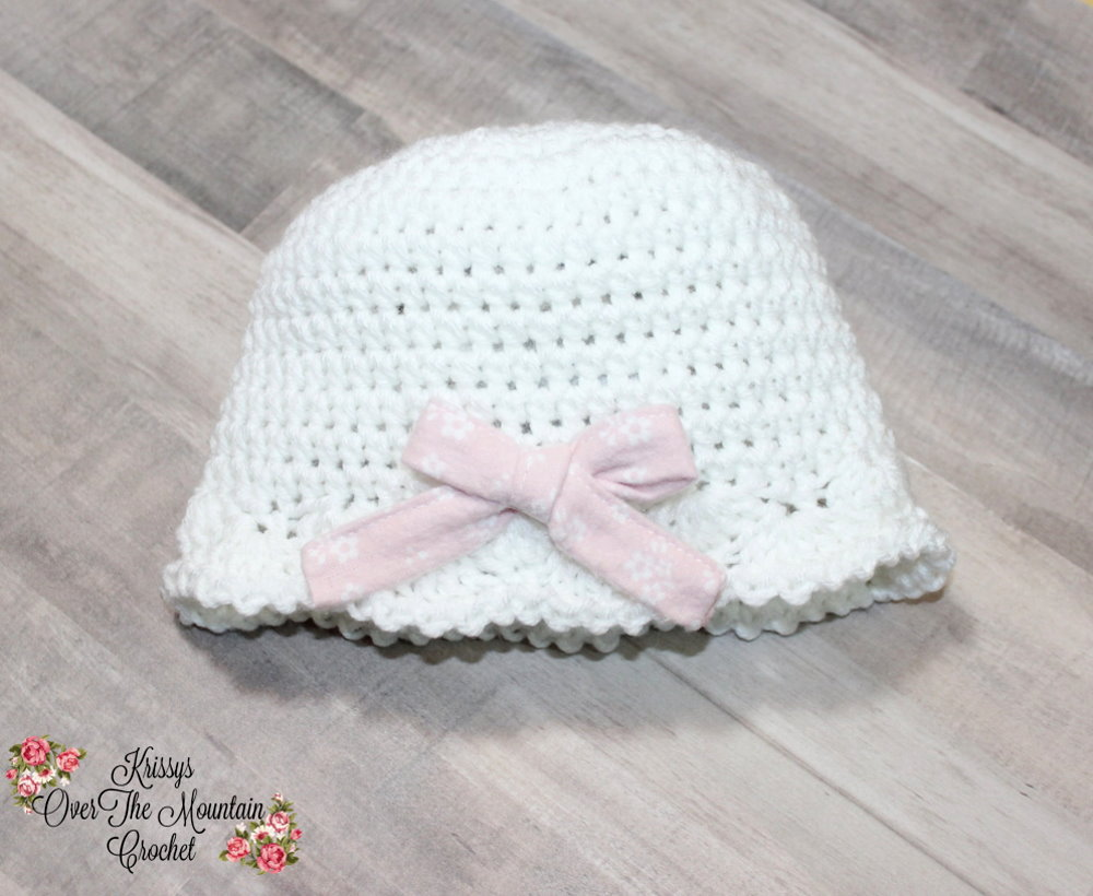 Crochet this shell hat. It is super sweet and super easy.