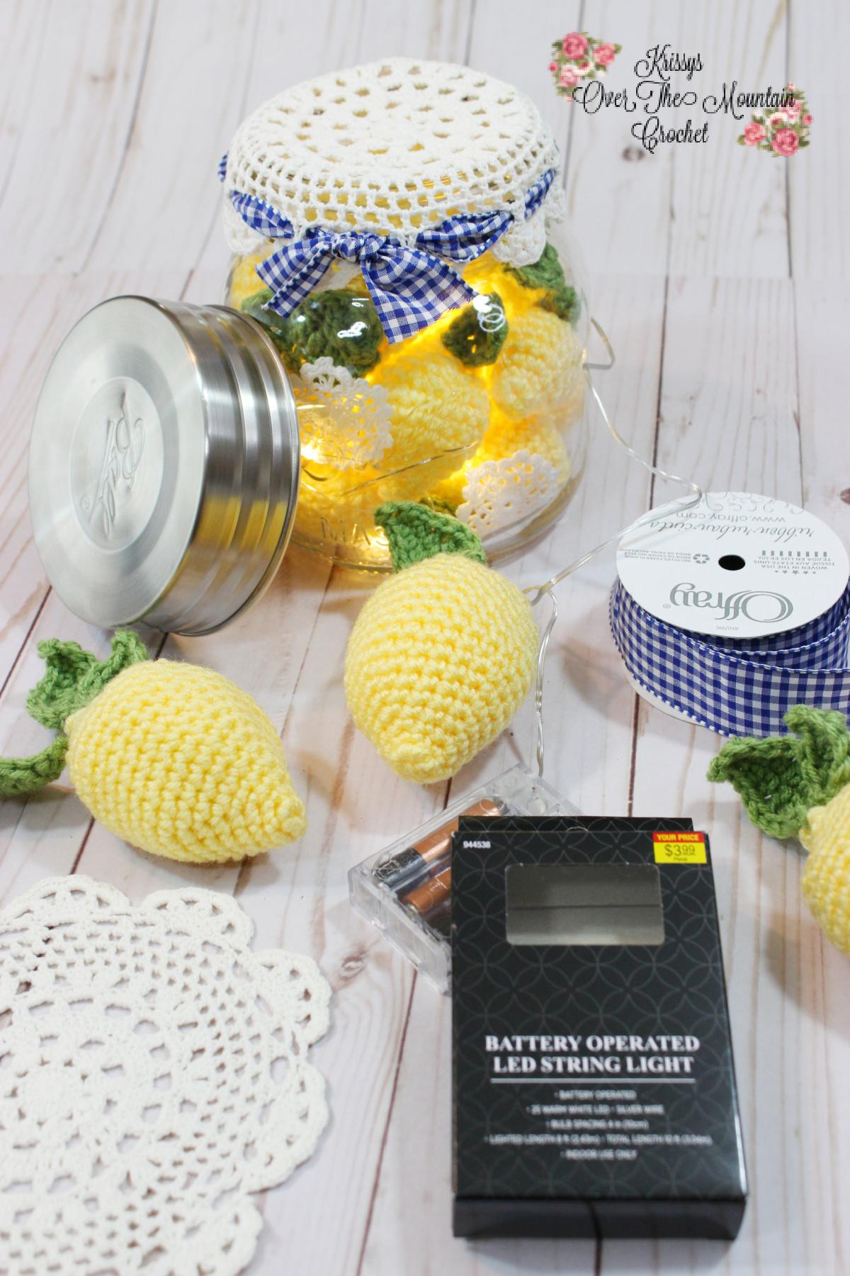 Mason Jar full of crochet Lemons, add lights for a beautiful centerpiece for your Lemon Farmhouse Table.