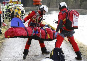 Rescue teams salvage an injured person at the site of a train accident near Bad Aibling,Germany, Tuesday, Feb. 9, 2016. Several people were killed when two trains collided head-on. (Uwe Lein/dpa via AP)