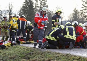 Emergency personnel treat injured persons at the site of a train accident near Bad Aibling, Germany, Tuesday, Feb. 9, 2016. Several people were killed in the crash. (Uwe Lein/dpa via AP)