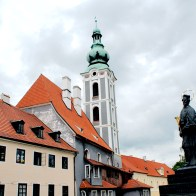Red roofs, bell tower and saint statue