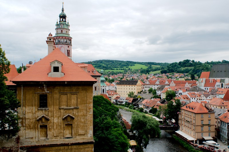 Tower, green hills, red roofs