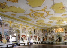 Baroque-style hall, with painted walls and ceilings, and chendeliers