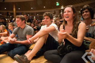 Students cheer at a talent show on a ship.