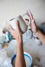 Laura Cooke of Cooke Ceramics at work on her porcelain ceramic pieces in her studio space at Clayspace.