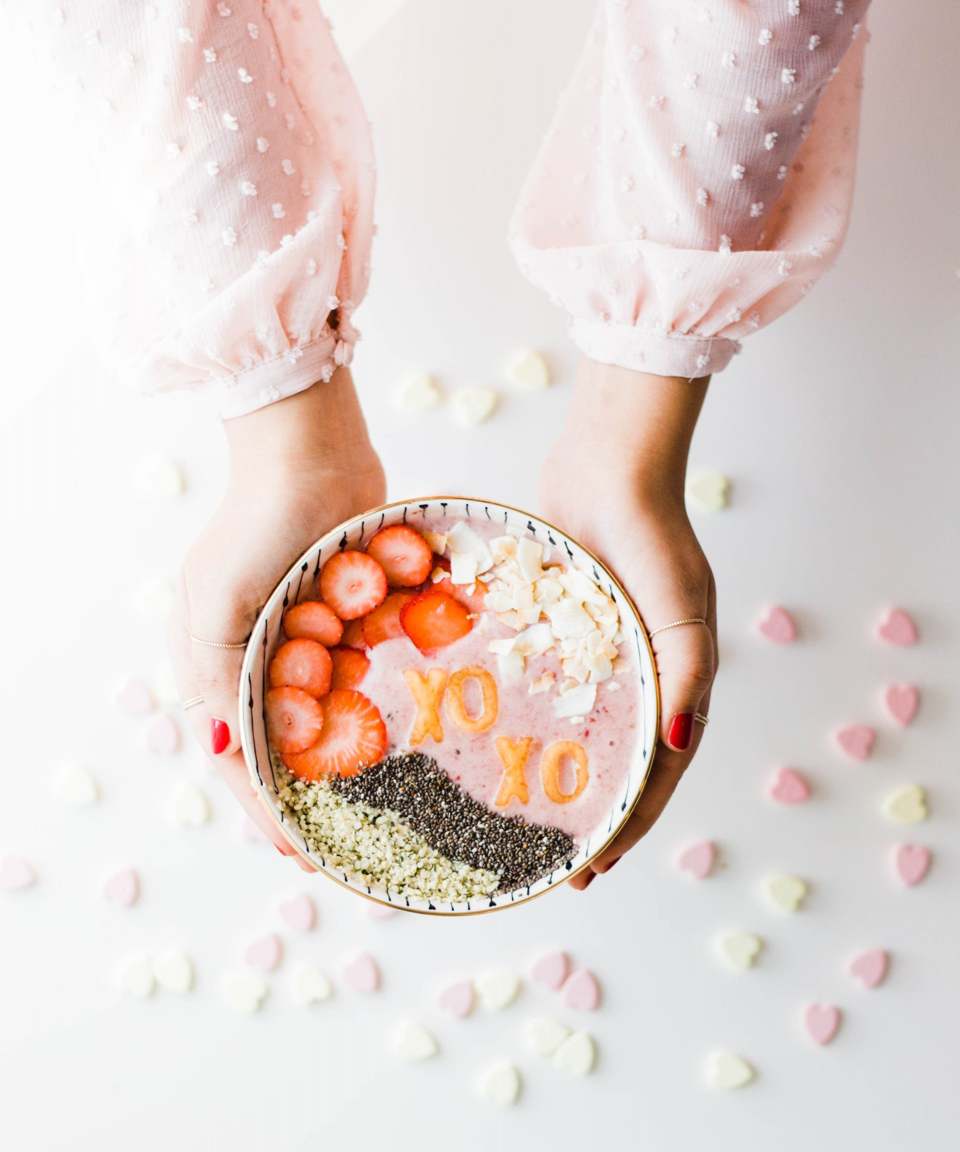 Valentine's Day Smoothies Bowl— This Strawberry-Banana-Coconut Smoothie bowl with letter-shaped fruits, was inspired by the little candy hearts with sweet messages. It makes for the perfect V-day healthy treat!