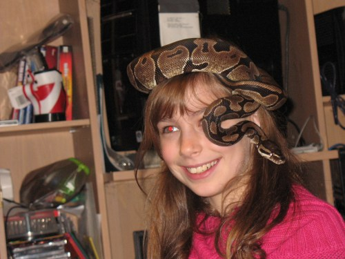 Faith visiting a friend's python.  He had not yet eaten.  Probably she shouldn't have put him on her head.