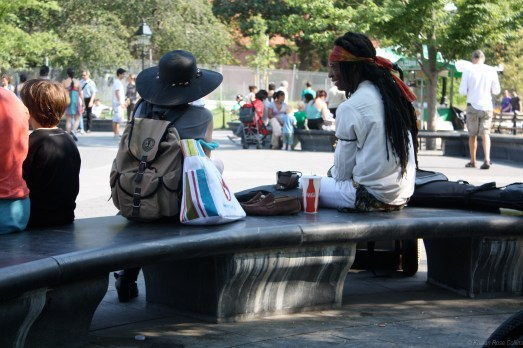 Two friends catching up at Washington Square Park