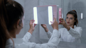 Commercial makeup model with mirror with bright lipstick