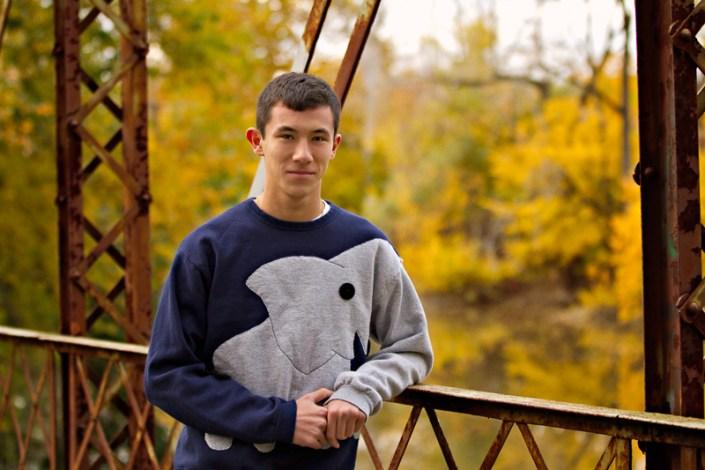 Teen boy on bridge